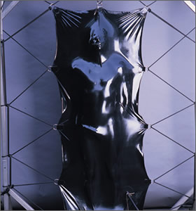 Body suspended within a vacuum bed