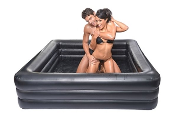 Inflatable lube wrestling ring