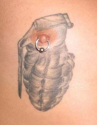 nipple tattoed with a hand granade